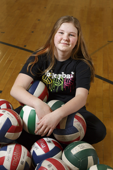 jessica frase with lots of volleyballs