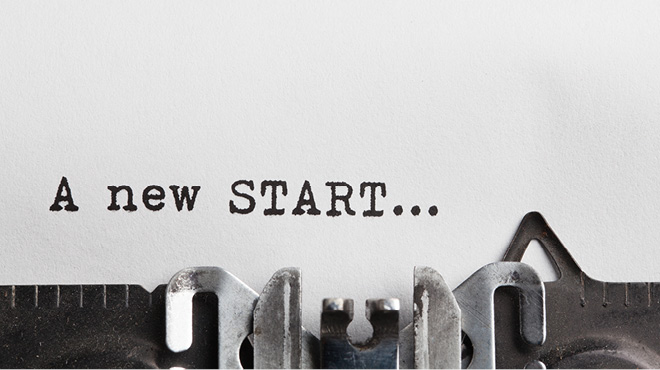 A new start in text on a typewriter