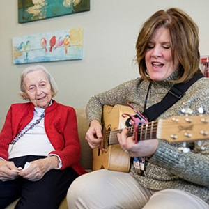 Angela Joan Adkins has unspecified dementia. Her music therapist, Roxie Raykovich, part of the Hospice team,  took a unique approach to bring back special memories by playing a song written by Joan's son, Guy, who passed away after a battle with cancer.