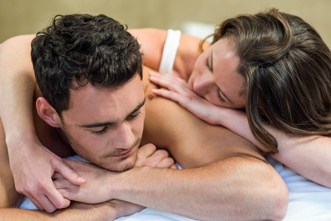 couple-in-bed-with-woman-consoling-man