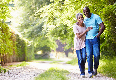 middle-aged-african-american-couple-walking-outdoors