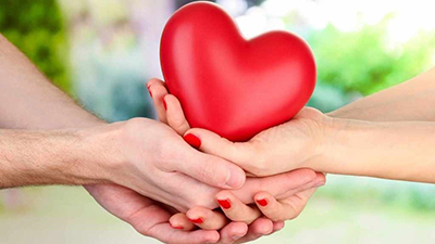 heart-being-held-by-male-and-female-hands