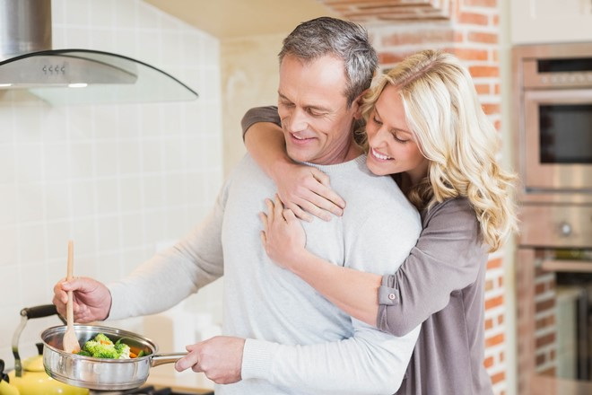 Man cooking healthy meal with woman