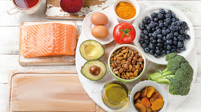 Healthy foods: Salmon, eggs, nuts, avocado, broccoli, blueberries