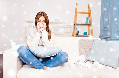 sick-woman-on-couch-winter-theme
