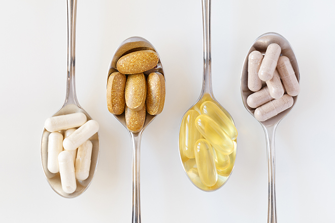 supplement-pills-on-spoons