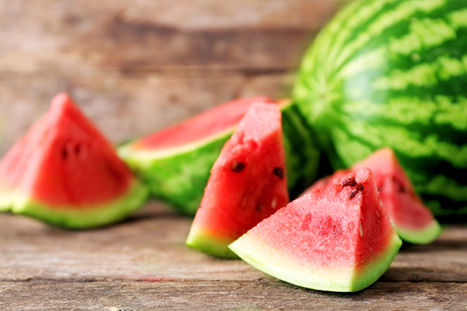 fresh-watermelon-cut-with-wood-background