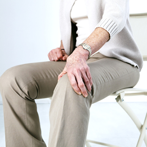 woman sitting holding knee