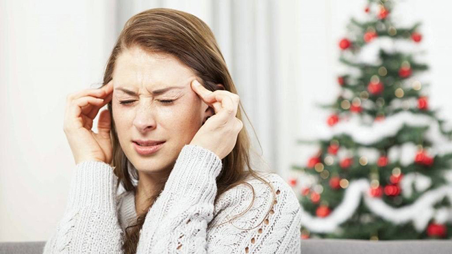 woman-stressed-with-a-headache-at-the-Christmas-holidays