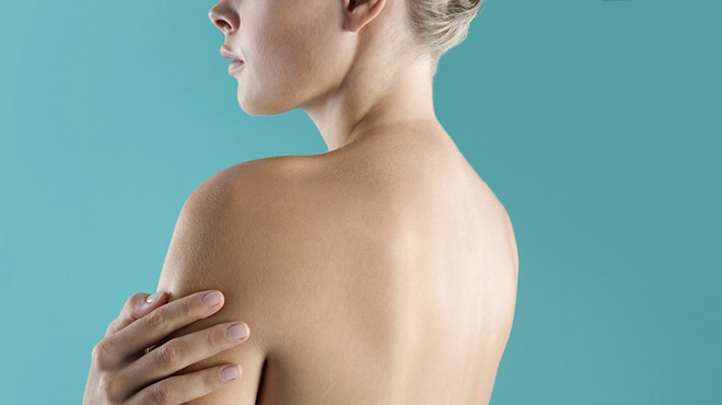 woman with bare upper back