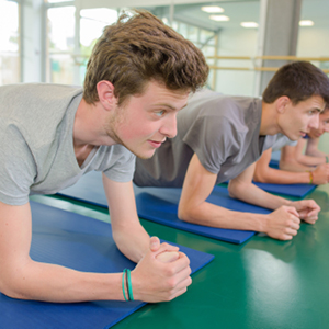 Young male athletes doing yoga