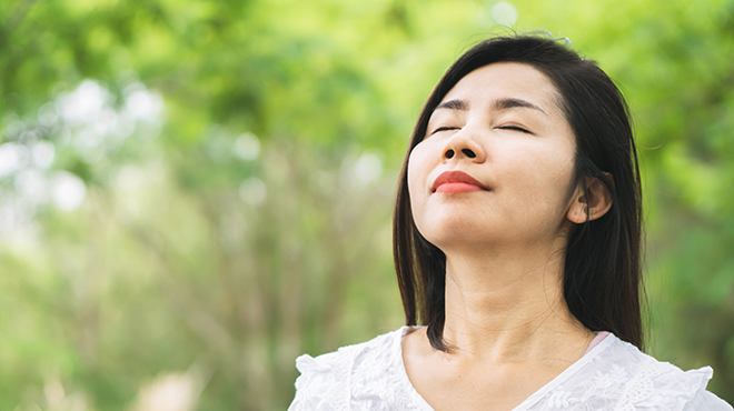 Asian woman breathing fresh air
