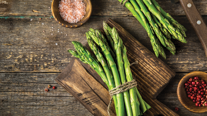 Asparagus and sea salt on wood table