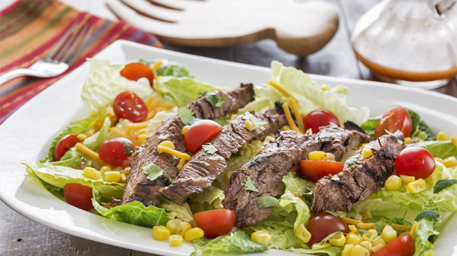 Salad with steak corn and tomatoes