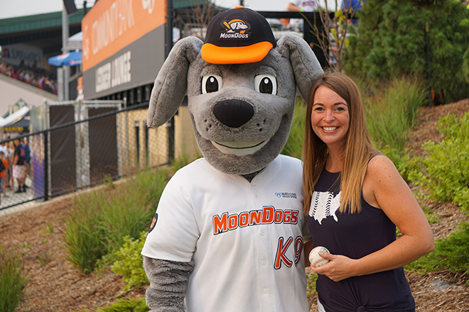 samantha-kaul-standing-with-moondogs-mascot-muttnik