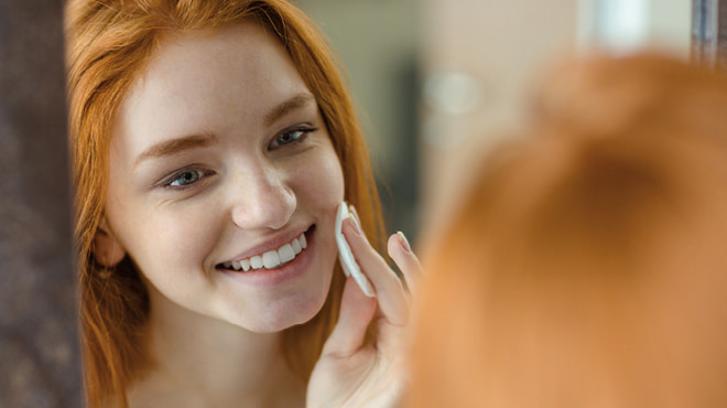 Teenage girl doing face care