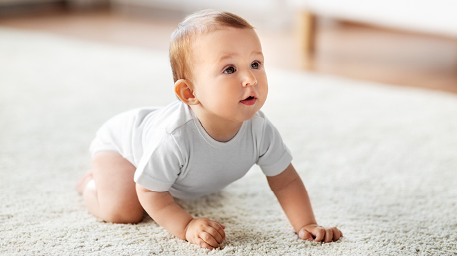 Infant crawling on carpet