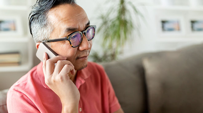 Man with glasses on cellphone