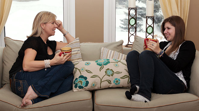 Teen and mom talking on sofa