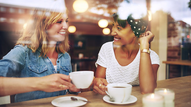 Two women enjoying a cup of coffee