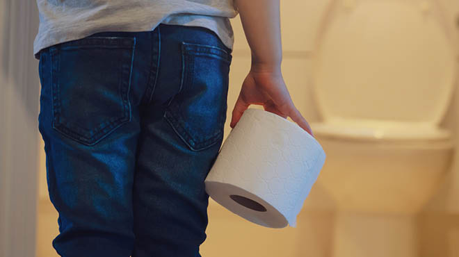 Child holding toilet paper roll