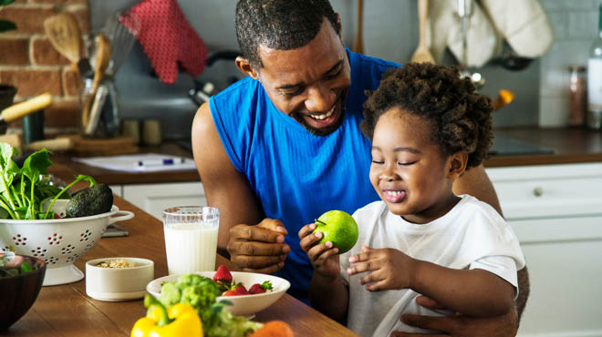 Dad and child sharing nutritious food