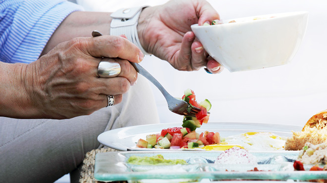 Forking vegetable salsa on plate