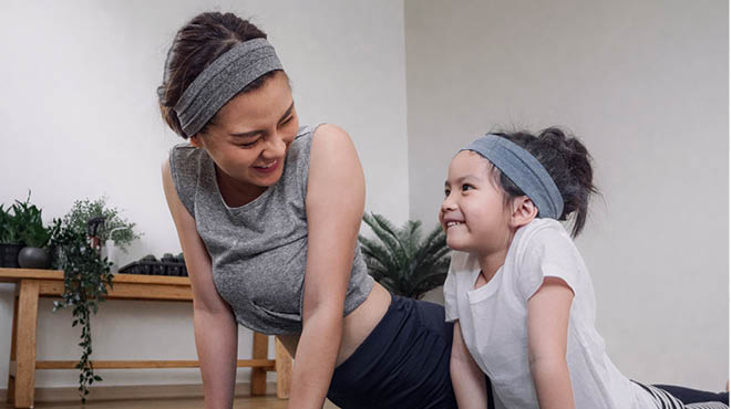 Mother and child exercising