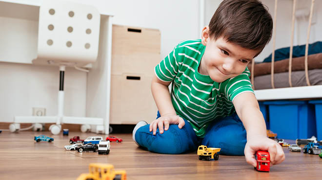 Playing with toy cars and trucks