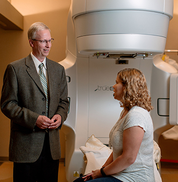 Dr Ron Smith Radiation Oncology With Patient